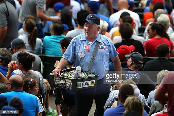 A beer vendor sells beer in the stands during the game between the San Francisco Giants and Chicago Cubs at Wrigley Field on Saturday August 8 2015...