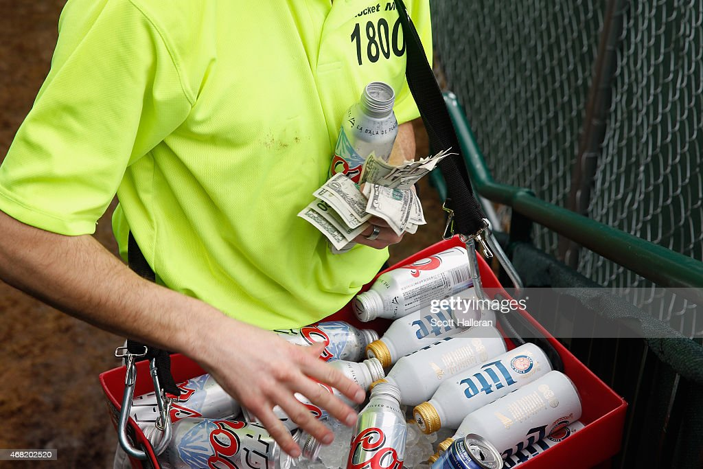 A beer vendor works around the par-three 16th hole during the third round of the Waste Management Phoenix Open at TPC Scottsdale on January 31, 2015 in Scottsdale, Arizona.