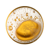 Beer with bubble on glass circle isolated on white background top view