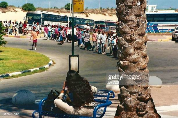 Beersheba street scene, a woman soldier and in the background, a group of Falashas - Beta Israel