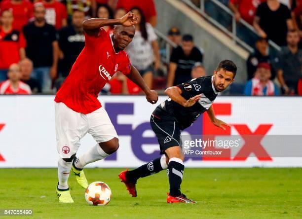 BeerSheva's Nigerian forward Anthony Nwakaeme vies for the ball with Lugano's Swiss defender Fulvio Sulmoni during the UEFA Europa League football...