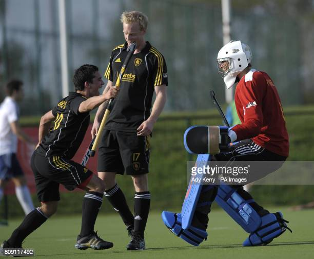 Beeston's Ben Arnold Alastair Wilson and George Pinner celebrate winning their England Hockey League Premier Division playoff final at Cannock...