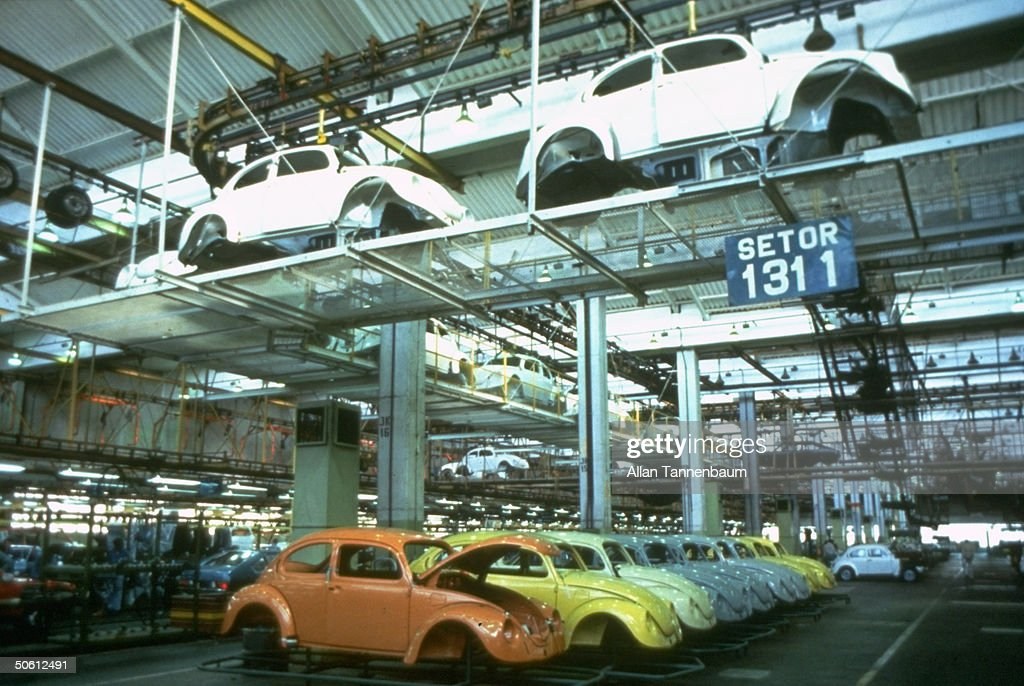 Beetle car bodies lining floor of Volkswagen production plant, re 1993 mfg. resumption by on Autolatina (Ford & VW S. Amer. merger) after 1986 phase out.