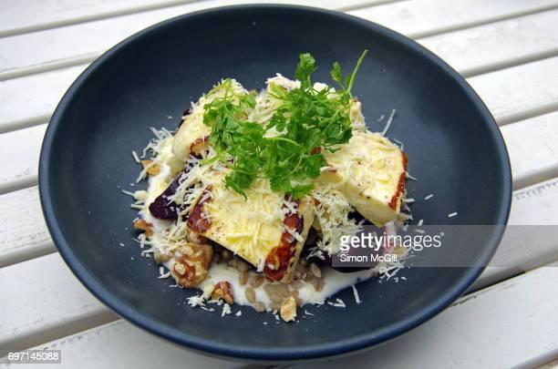 Beetroot and haloumi salad with barley, honey yoghurt, preserved lemon, walnuts and chervil