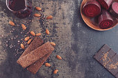Gluten free chocolate and beetroot brownies on rustic background. Top view, vintage toned image, blank space
