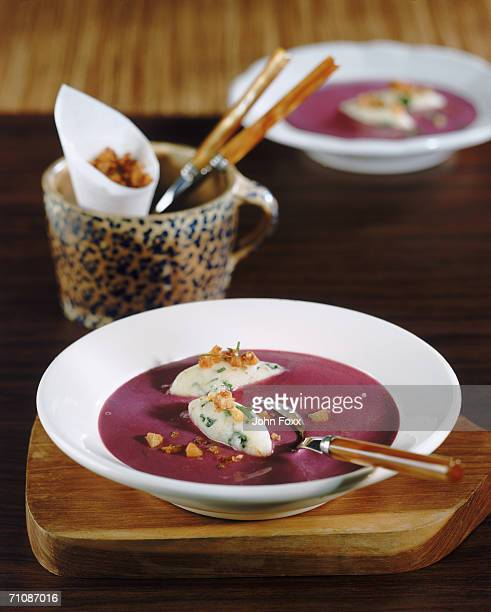 Beetroot soup and crouton in bowl, close-up