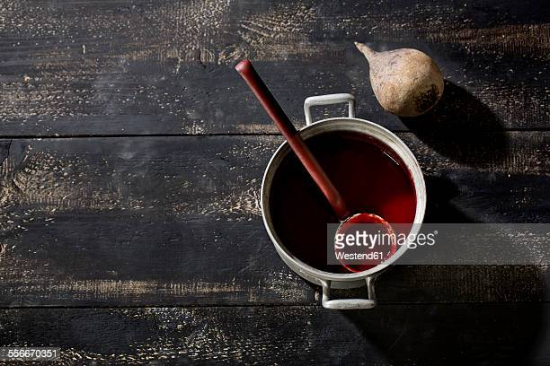 Beetroot soup in cooking pot