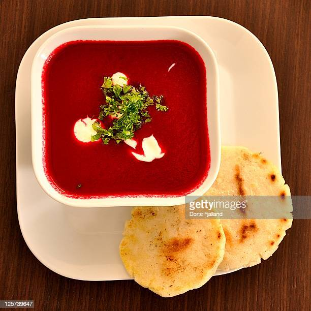 Beetroot soup served in square white plate