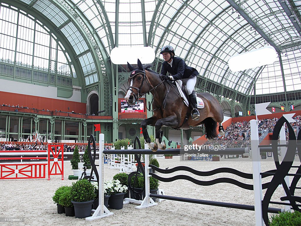 <a gi-track='captionPersonalityLinkClicked' href=/galleries/search?phrase=Beezie+Madden&family=editorial&specificpeople=628976 ng-click='$event.stopPropagation()'>Beezie Madden</a> and her horse Coral Reef Via Volo clear an obstacle at the Saut Hermes International Show Jumping Competition in Paris on April 15, 2011. The show features many of the world's top show-jumpers.