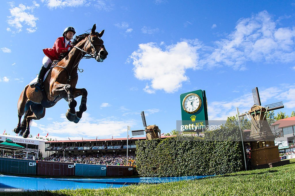 <a gi-track='captionPersonalityLinkClicked' href=/galleries/search?phrase=Beezie+Madden&family=editorial&specificpeople=628976 ng-click='$event.stopPropagation()'>Beezie Madden</a> of the United States riding Simon competes in the individual jumping equestrian on the final day of the Masters tournament at Spruce Meadows on September 14, 2014 in Calgary, Alberta, Canada.