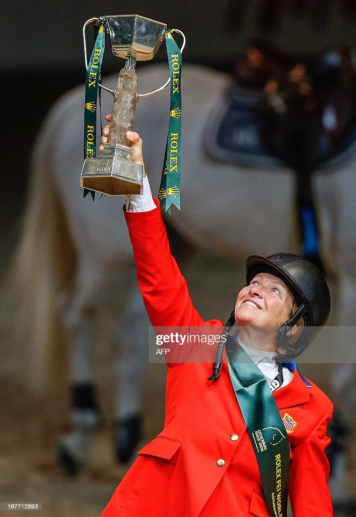 Beezie Madden of the US holds the trophy after winning the Rolex FEI World Cup Jumping final on April 28, 2013 during the Gothenburg Horse Show in Scandinavium.