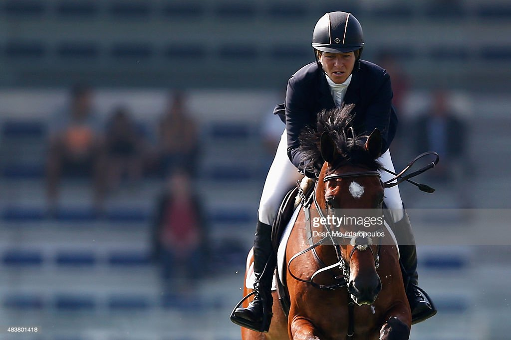 <a gi-track='captionPersonalityLinkClicked' href=/galleries/search?phrase=Beezie+Madden&family=editorial&specificpeople=628976 ng-click='$event.stopPropagation()'>Beezie Madden</a> of the USA riding Simon competes in the Class 01, CSI5* 1.45m Two Phases: A + A, against the clock during the Longines Global Champions Tour held at Stal Tops on August 13, 2015 in Valkenswaard, Netherlands.