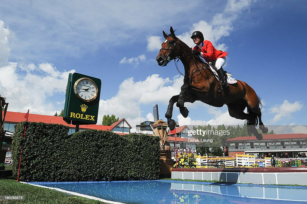 <a gi-track='captionPersonalityLinkClicked' href=/galleries/search?phrase=Beezie+Madden&family=editorial&specificpeople=628976 ng-click='$event.stopPropagation()'>Beezie Madden</a> of USA riding Simon competes in the individual jumping equestrian on the final day of the Masters tournament at Spruce Meadows on September 8, 2013 in Calgary, Alberta, Canada. Beezie placed 6th with a second round time of 71.27 seconds and 5 faults.