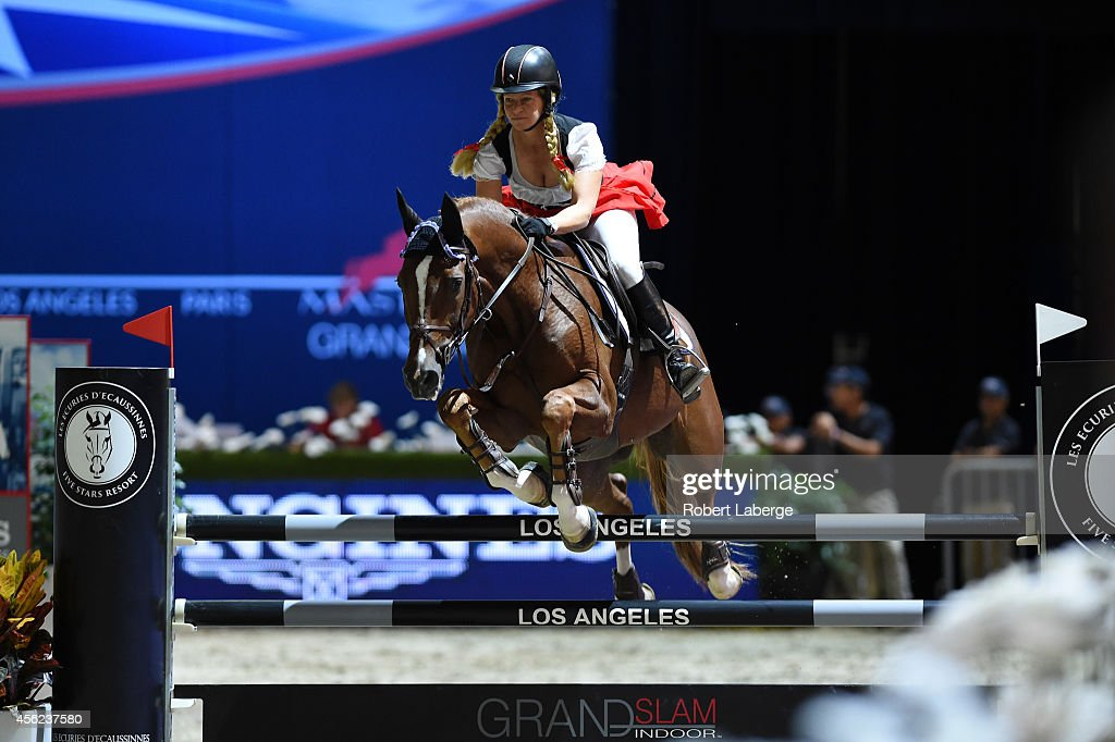 <a gi-track='captionPersonalityLinkClicked' href=/galleries/search?phrase=Beezie+Madden&family=editorial&specificpeople=628976 ng-click='$event.stopPropagation()'>Beezie Madden</a> performs during the Charity Pro-AM class at Longines Los Angeles Masters at Los Angeles Convention Center on September 27, 2014 in Los Angeles, California.