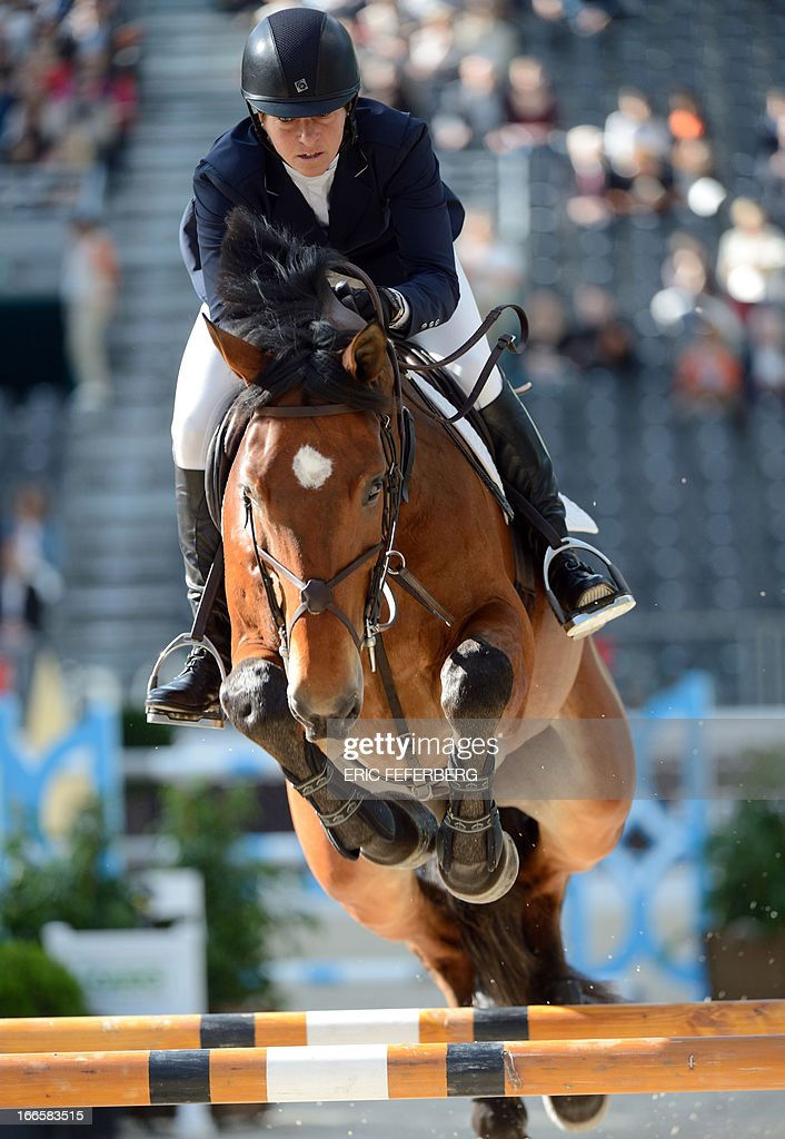 US Beezie Madden riding Simon competes in the International Jumping Competition 'Grand Prix Hermes' on April 14, 2013, at the Grand Palais in Paris.