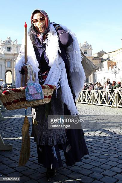 Befana gathered in St Peter's Square during the Feast of the Epiphany attends the Pope Francis' Angelus blessing on January 6 2014 in Vatican City...