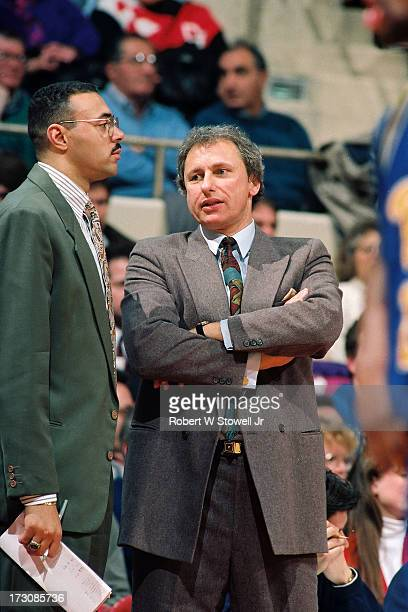 Before a game University of Connecticut Assistant coaches Dave Leito and Howie Dickenman talk on the sidelines Hartford Connecticut 1988
