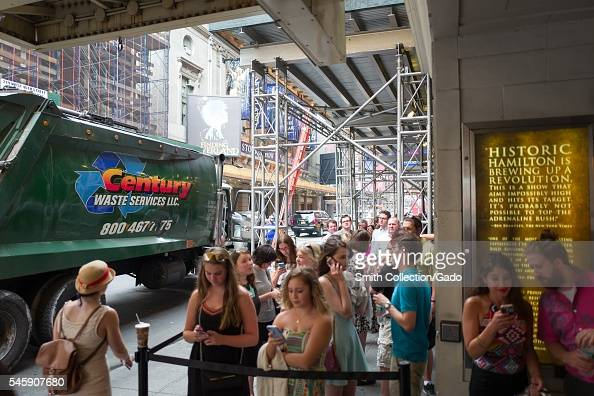 Before a performance of the Broadway musical Hamilton two days prior to creator Lin Manuel Miranda's departure from the show fans wait in line and...