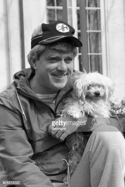 Before departing for Chicago talkshow host Phil Donahue stops to relax and pose with his Maltese dog Teeda Winning a national daytime Emmy award in...