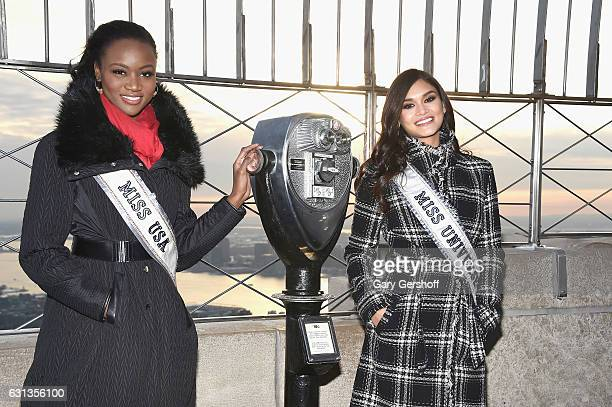 Before leaving for the Miss Universe competition Miss USA 2016 Deshauna Barber and Miss Universe 2015 Pia Alonza Wurtzbach visit the Empire State...