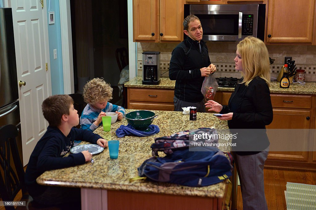 Before leaving for the school bus stop, Turner Carroll, 9, L, and Cooper Carroll, 5, eat breakfast alongside their parents, Matt and Susan Carroll at their home on Thursday, January 17, 2012, in Ashburn, VA. Rapid growth in northern Virginia has caused school boundary shuffles that cause family and neighborhood upheavals. The Carrolls' neighborhood, Belmont Glen, has been redistricted 4 times in the last decade.