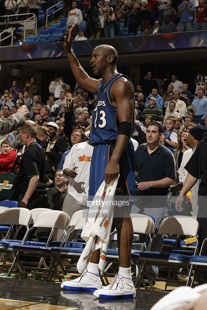 Before playing his final game against the Cleveland Cavaliers, Michael Jordan #23 of the Washington Wizards waves to the fans at Gund Arena on April 8, 2003 in Cleveland, Ohio. The Wizards won 100-91.