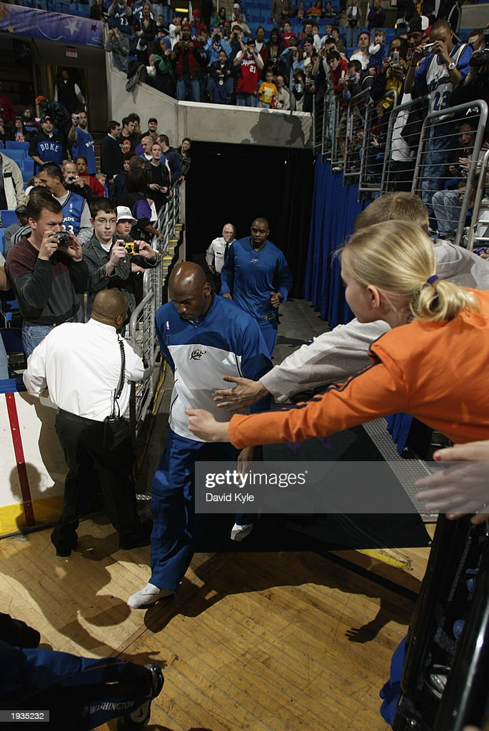 Before playing his final game against the Cleveland Cavaliers, Michael Jordan #23 of the Washington Wizards enters the Gund Arena on April 8, 2003 in Cleveland, Ohio. The Wizards won 100-91.