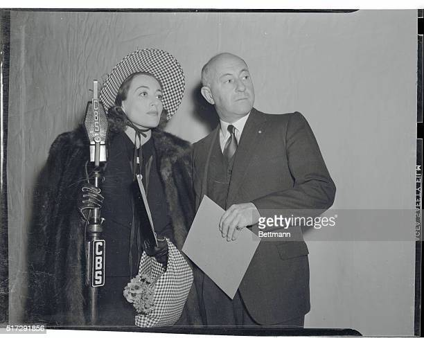 Before the curtain rose on the broadcast of a play Joan Crawford and Director Cecil B DeMille confer just before the movie star went on the air in...