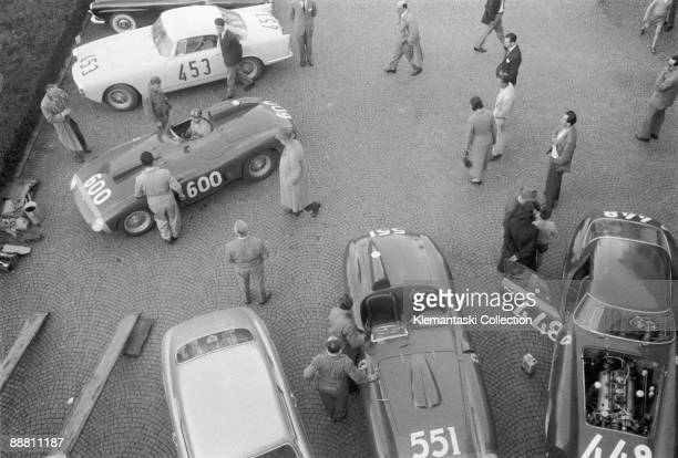 Before the Mille Miglia Manerbio April 1956 On top of Klemantaski�s mesmerizing pattern of pavè the Ferrari team prepares to depart for the start N...
