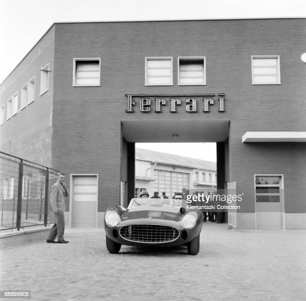 Before The Mille Miglia Maranello May 1957 Peter Collins in his Ferrari 335 Sport leaving the Factory�s main gate on a short test up the Abetone road...