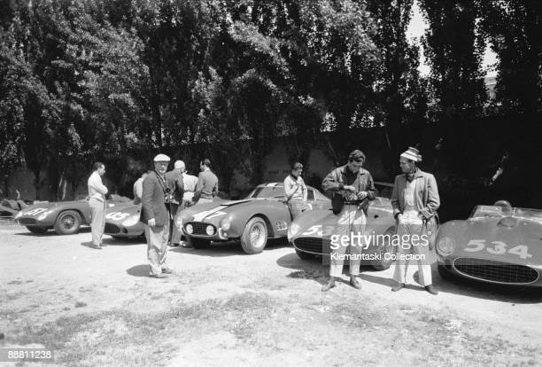 Before The Mille Miglia Maranello May 1957 The Ferrari team lined up in the factory yard before the 1957 Mille Miglia Olivier Gendebien leans against...