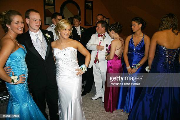 Before the South Portland prom Liza DeCesare Chris Foster and Esther Palmieri smile for the cameras as their friends mingle in the background staff...