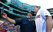 Before throwing out a ceremonial first pitch New England Patriots tight end Rob Gronkowski posed for a selfie with a Boston police officer near the...