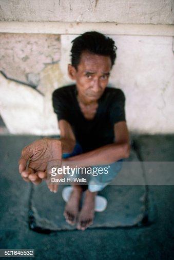 Beggar Asking for Money