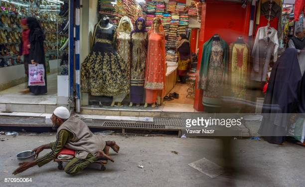 A beggar asks for alms from passersby in a market on November 06 2017 in Srinagar the summer capital of Indian administered Kashmir India Markets in...