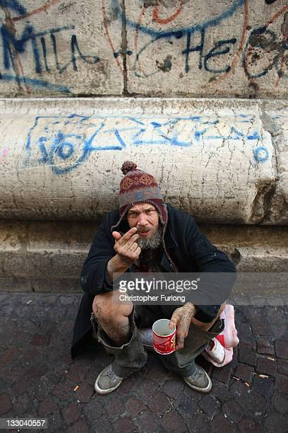 A beggar asks for loose change in central Naples on November 16 2011 in Naples Italy Italian Prime Minster designate Mario Monti has selected his new...