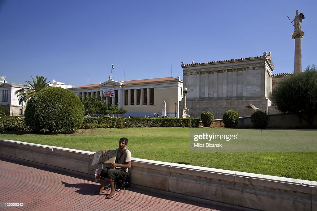 A beggar holds a poster reading 'I'm hungry' in front of Athens University in downtown Athens on September 15, 2011 in Greece. As Greece's position in the Eurozone remains uncertain, a cabinet meeting today discussed how the country may implement a new round of austerity measures in order to fend off default and to ensure they continue to receive rescue loans. The troubled country is in its third year of recession and unemployment has risen to 16.3% compared with 11.8% this time last year.