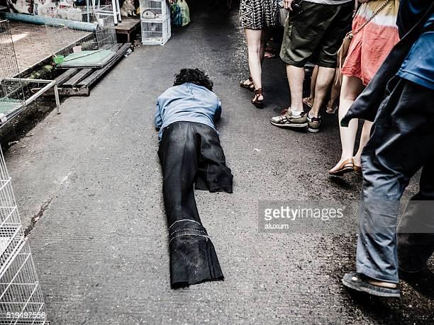 Beggar in Chatuchak market Bangkok Thailand
