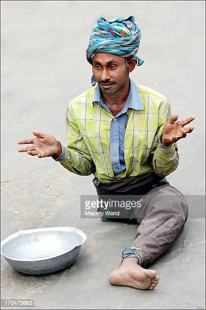 A beggar in front of the Chittagong Jame Masjid Chittagong Bangladesh October 19 2006