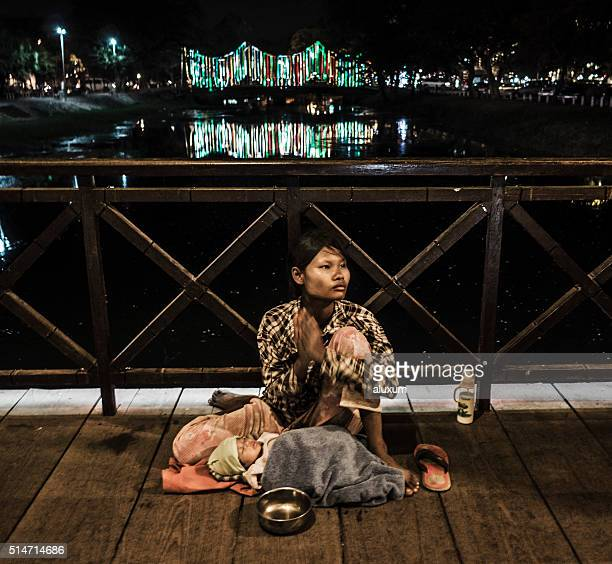 Beggar with child in Siem Reap Cambodia