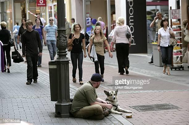 GERMANY BONN Beggar with dog in the city center of Bonn