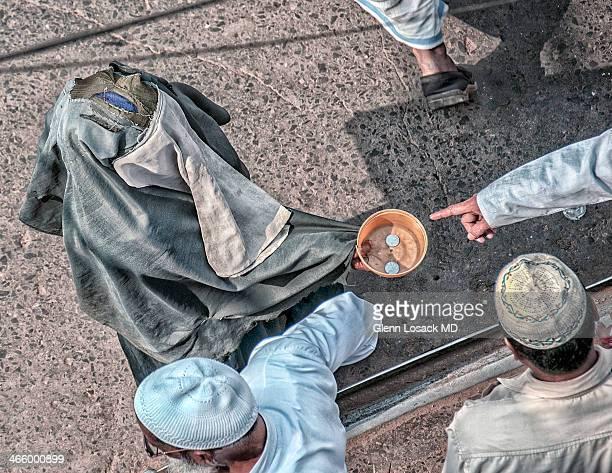 CONTENT] Beggars at friday Muslim prayer this one dressed in torn Burka Kolkata INDIA