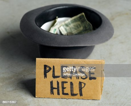 Beggar's Hat with Money and Sign