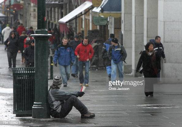 A begger asks for money in central Oslo on February 25 2007 in Oslo Norway