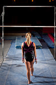 Frozen in time: Advanced Gymnast about to begin her uneven bars routine. There is something silent, powerful, and gripping about her approach.