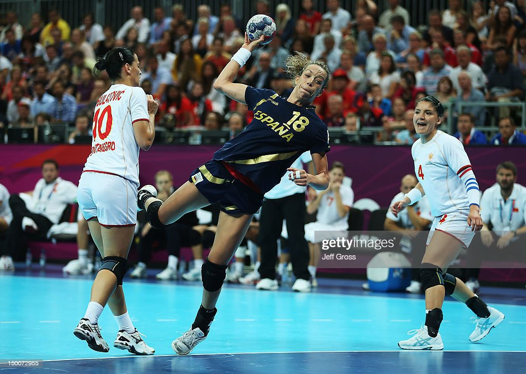 Begona Fernandez Molinos #18 of Spain shoots between Andela Bulatovic (L) #10 and Jovanka Radicevic #4 of Montenegro during the Women's Handball semifinal game between Spain and Montenegro on Day 13 of the London 2012 Olympic Games at the Basketball Arena on August 9, 2012 in London, England.