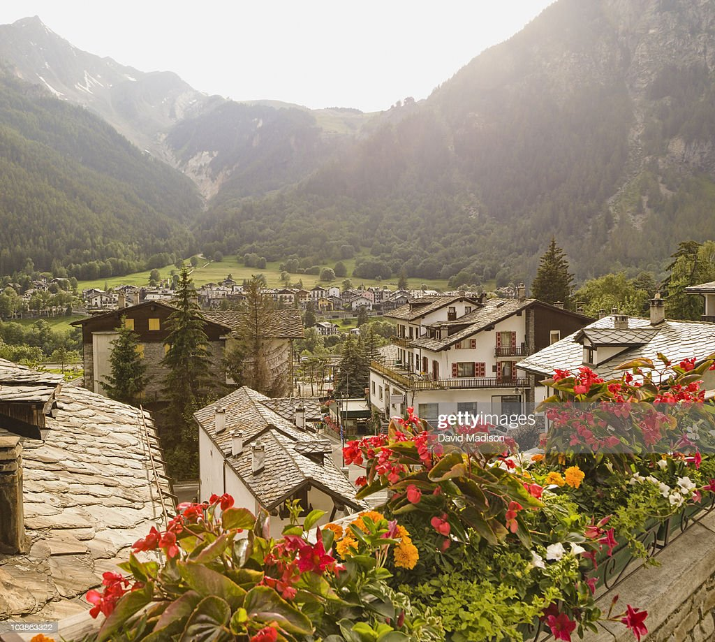 Begonia pots and view of Courmayeur.