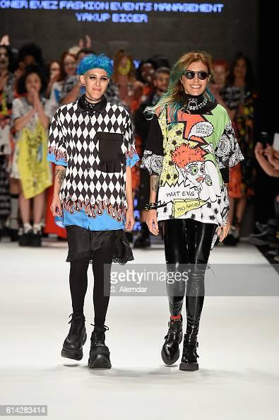 Begum Berdan and Deniz Berdan walk the runway at the DB Berdan show during MercedesBenz Fashion Week Istanbul at Zorlu Center on October 13 2016 in...