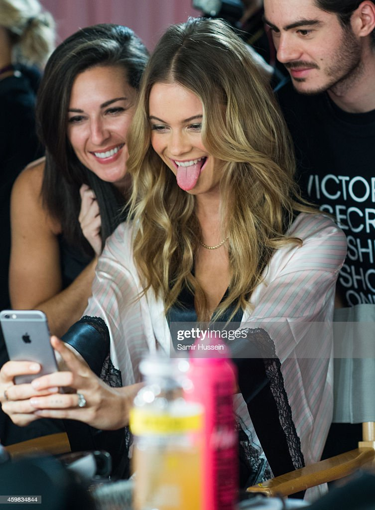 Behati Prinsloo takes a photo of herself backstage at the annual Victoria's Secret fashion show at Earls Court on December 2, 2014 in London, England.