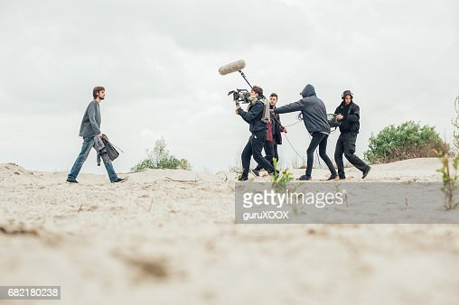 Behind the scene. Film crew filming movie scene outdoor : Stock Photo